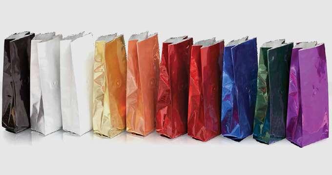 Bolsa para Café 3.35x2.3x9.5 aluminizada color plateada 8 zs (1/2 libra) con válvula (1000)
